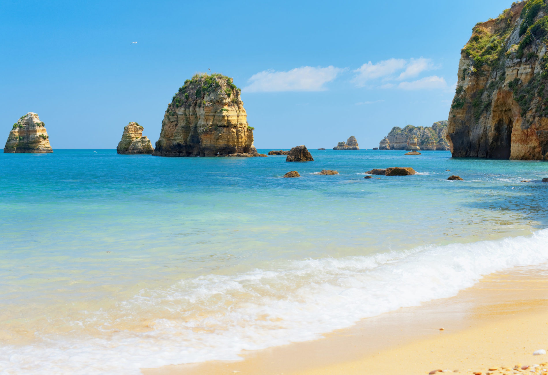 Rocks and sandy beach in Lagos, Portugal